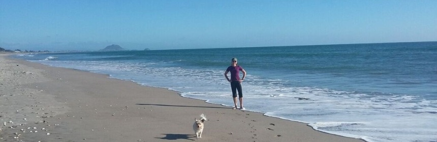 Photo of Margaret Cunningham and 'Dixie' on Papamoa Beach